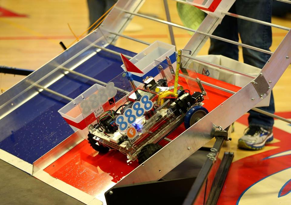 Team Infinity Factor's robot during competition at the Massachusetts First Tech Challenge State Championships at Natick High School.